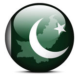 Map on flag button of Islamic Republic Pakistan Stock Photos
