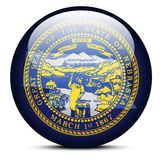 Map on flag button of USA Nebraska State Royalty Free Stock Photos