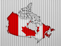 Map and flag of Canada on corrugated iron Royalty Free Stock Photography