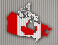 Map and flag of Canada on corrugated iron Stock Photos