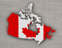 Map and flag of Canada on old linen Stock Image