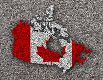 Map and flag of Canada on poppy seeds Royalty Free Stock Photo