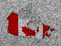 Map and flag of Canada on poppy seeds Stock Images