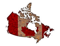 Map and flag of Canada on rusty metal Royalty Free Stock Images