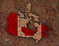 Map and flag of Canada on rusty metal Royalty Free Stock Photography