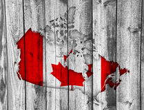 Map and flag of Canada on weathered wood Stock Photo