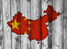 Map and flag of China on weathered wood Royalty Free Stock Photography