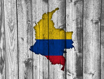 Map and flag of Colombia on weathered wood. Colorful and crisp image of map and flag of Colombia on weathered wood vector illustration