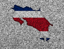Map and flag of Costa Rica on poppy seeds Royalty Free Stock Image