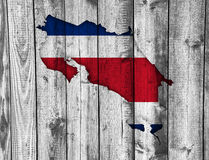 Map and flag of Costa Rica on weathered wood Royalty Free Stock Photo