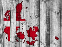 Map and flag of Denmark on weathered wood. Colorful and crisp image of Denmark on weathered wood Stock Photography