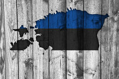 Map and flag of Estonia on weathered wood Royalty Free Stock Photos