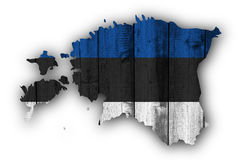 Map and flag of Estonia on weathered wood Royalty Free Stock Photography