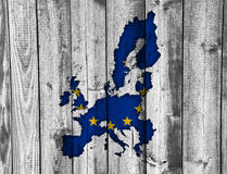 Map and flag of the EU on weathered wood. Colorful and crisp image of map and flag of the EU on weathered wood Stock Image