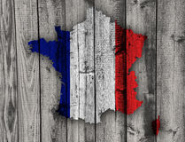 Map and flag of France on weathered wood. Colorful and crisp image of France on weathered wood Royalty Free Stock Images
