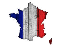Map and flag of France on weathered wood. Colorful and crisp image of France on weathered wood Stock Photos