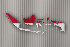 Map and flag of Indonesia on corrugated iron Stock Images