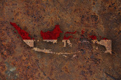 Map and flag of Indonesia on rusty metal. Colorful and crisp image of map and flag of Indonesia on rusty metal stock photos