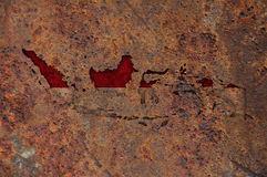 Map and flag of Indonesia on rusty metal royalty free illustration