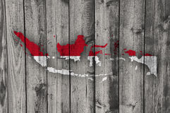 Map and flag of Indonesia on weathered wood. Colorful and crisp image of map and flag of Indonesia on weathered wood stock photos