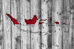 Map and flag of Indonesia on weathered wood. Colorful and crisp image of map and flag of Indonesia on weathered wood royalty free stock images