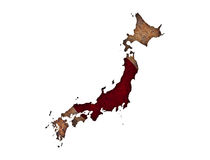 Map and flag of Japan on rusty metal Royalty Free Stock Images