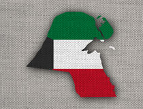 Map and flag of Kuwait on old linen Royalty Free Stock Photos
