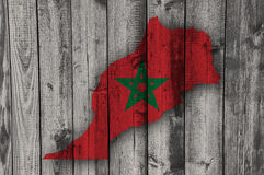 Map and flag of Morocco on weathered wood. Colorful and crisp image of map and flag of Morocco on weathered wood royalty free stock images