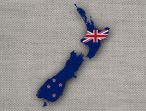 Map and flag of New Zealand on linen, Royalty Free Stock Photography
