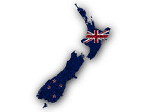 Map and flag of New Zealand on poppy seeds Royalty Free Stock Image
