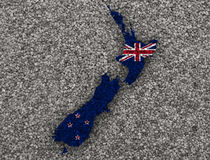 Map and flag of New Zealand on poppy seeds, Stock Photography