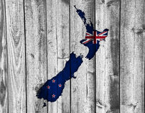 Map and flag of New Zealand on wood, Royalty Free Stock Photos