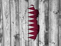 Map and flag of Qatar on weathered wood Stock Image