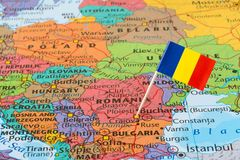 Romania map and flag pin. Map with flag of Romania, it is a sovereign state located in Southeastern Europe royalty free stock photography