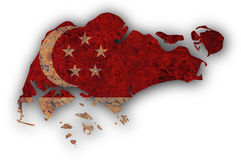 Map and flag of Singapore on rusty metal Royalty Free Stock Photo