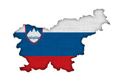 Map and flag of Slovenia on old linen Royalty Free Stock Photos