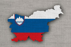 Map and flag of Slovenia on old linen Royalty Free Stock Photo