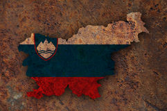 Map and flag of Slovenia on rusty metal Royalty Free Stock Images
