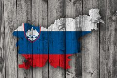 Map and flag of Slovenia on weathered wood Royalty Free Stock Photography