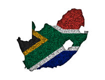 Map and flag of South Africa on poppy seeds Royalty Free Stock Images