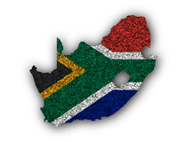 Map and flag of South Africa on poppy seeds Royalty Free Stock Photo