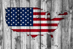 Map and flag of the USA on weathered wood Royalty Free Stock Image
