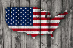 Map and flag of the USA on weathered wood. Colorful and crisp image of map and flag of the USA on weathered wood royalty free stock photography