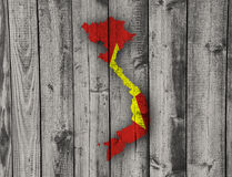 Map and flag of Vietnam on weathered wood Royalty Free Stock Photography