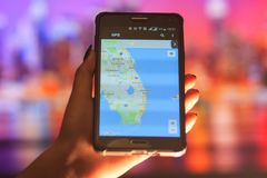 Map of Florida on the phone in the background of a night city. Close Up Of Woman Hand Holding Mobile Phone. Close Up Of Woman Hand Holding Mobile Phone. map of royalty free stock images