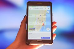 Map of Florida on the phone in the background of a night city. Close Up Of Woman Hand Holding Mobile Phone. Close Up Of Woman Hand Holding Mobile Phone. map of stock image