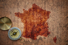 Map of france on a old vintage crack paper. Background with compass Stock Photo