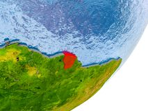 Map of French Guiana on Earth. 3D render of French Guiana on political globe with embossed countries with real land surface and water in place of ocean. 3D Royalty Free Stock Images