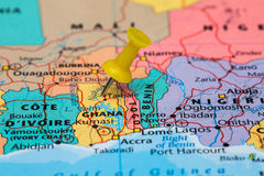 Map of  Ghana with a yellow pushpin stuck Stock Image
