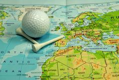 Map and golf. Map with golf ball and tees by British Isles Stock Images